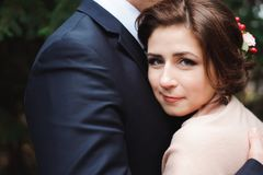 Bride and groom hugging in a forest in the autumn forest stock photo
