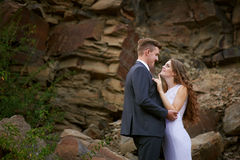 Bride and groom hugging in the mountains Stock Photo