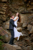 Bride and groom hugging in the mountains Royalty Free Stock Photo