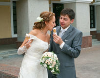 Bride and groom with ice-cream Stock Image