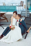 Bride and groom idoors at the pool Royalty Free Stock Image