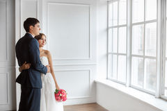 Bride and groom indoors Royalty Free Stock Photos