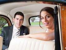Bride and groom inside a car Royalty Free Stock Photos