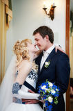 Bride and groom in interior Stock Images