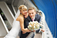 Bride and groom in interiors of Business Center Stock Images
