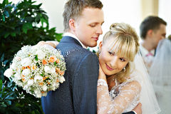 Bride and groom in interiors of marriage palace. Happy bride and groom in interiors of marriage palace Stock Photography