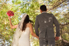 Bride and groom jumping Royalty Free Stock Photo