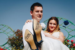 Bride and groom with `Just Married` written on shoe soles, Rome. Cityscape in the background, Italy Stock Photos