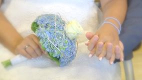 Bride and groom keeps to the hands with bridal bouquet. And ring stock video