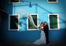 Bride and groom kiising in port Stock Photography