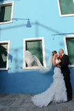 Bride and groom kiising in port Stock Image