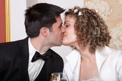 Bride and groom kiss Stock Photos
