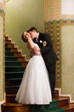 Bride and groom kiss Stock Images