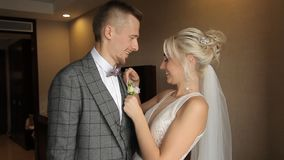 Bride and groom kiss. In the room stock video footage