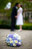 Bride Groom Kiss with Flowers Royalty Free Stock Photography