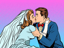 The bride and groom kiss. Pop art retro style. Man and woman at the wedding. Love couple Royalty Free Stock Photo