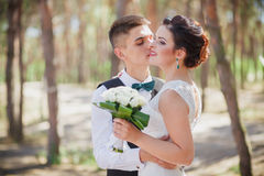The bride and groom kiss Royalty Free Stock Photo