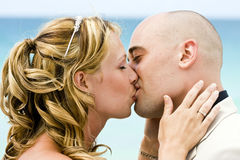 Bride and groom kissing. On a beach Royalty Free Stock Photos