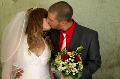 Bride and groom kissing stock photos
