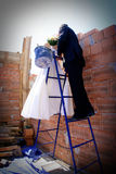 Bride and groom kissing Stock Photography