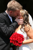 Bride and Groom Kissing. After wedding Royalty Free Stock Photo