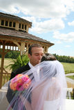 Bride and Groom kissing Royalty Free Stock Images