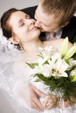 Bride and groom kissing Stock Images