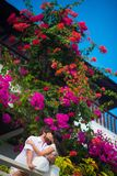 Bride and groom kissing on the balcony stock images