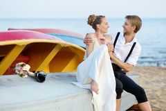 Bride and groom kissing on a beach Royalty Free Stock Photo
