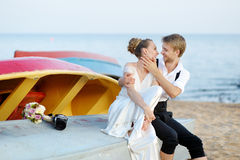 Bride and groom kissing on a beach Royalty Free Stock Photography