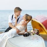 Bride and groom kissing on a beach Royalty Free Stock Image