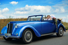 Bride and groom kissing in the car Royalty Free Stock Photo