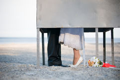 Bride and groom kissing in dressing cabin Stock Images