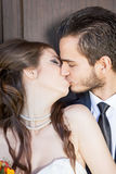 Bride and groom kissing each other Stock Image