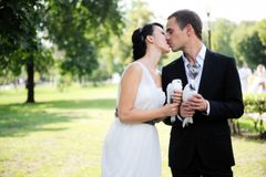 Bride and groom kissing each other outdoors Royalty Free Stock Photos