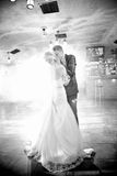 Bride and groom kissing during first dance Royalty Free Stock Image