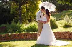 Bride and groom kissing in garden wedding Stock Images
