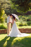 Bride and groom kissing in garden wedding Royalty Free Stock Photos