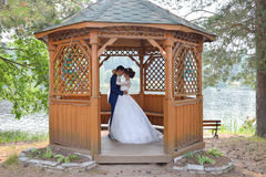 Bride and groom kissing insude summer house Royalty Free Stock Images