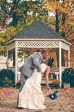 Bride and groom kissing on patio Stock Photos