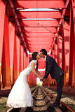 Bride and groom kissing on the railway Stock Images