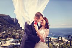 Bride and groom kissing with sea scape in background Stock Photo