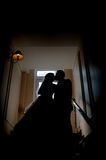 Bride and groom kissing silhouette Stock Image