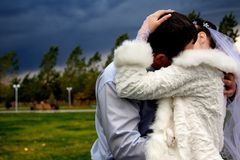 Bride and Groom Kissing  and storm sky Stock Image