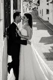 Bride and groom kissing in the street royalty free stock photo