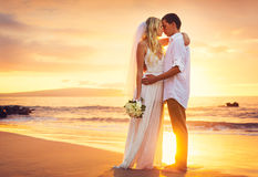 Bride and Groom, Kissing at Sunset on a Beautiful Tropical Beach stock images