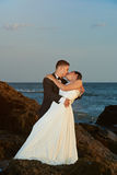 Bride and groom kissing on sunset light Royalty Free Stock Image