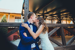 Bride and groom kissing tenderly Stock Photo