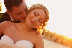 Bride and groom kissing. Bride and groom on their wedding day kissing Stock Photos