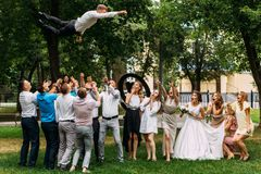 Newlyweds and guests having fun at the wedding stock image